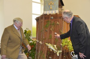 David Kilpatrick and the Moderator looking at the fishing net draped from the pulpit