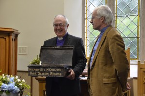 The Moderator and the parish Minister Rev. Dr. Ken Ross looking at a old records box