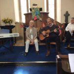 Ellen, Alwin, Neil and Phil singing